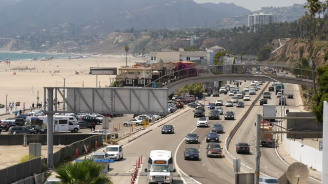 shows exterior shots traffic driving along the pacific coast highway alongside santa monica beach on 26th july 2017 in santa monica california usa - route 001 stock videos & royalty-free footage