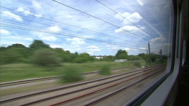 shows exterior shots train departing railway station and travelling through countryside on 13th june 2017 in england - berkshire england stock videos & royalty-free footage