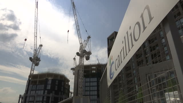 Shows exterior shots types of companies being run by Carillion including hospitals football stadiums and railways Timelapse shots chimneys of...