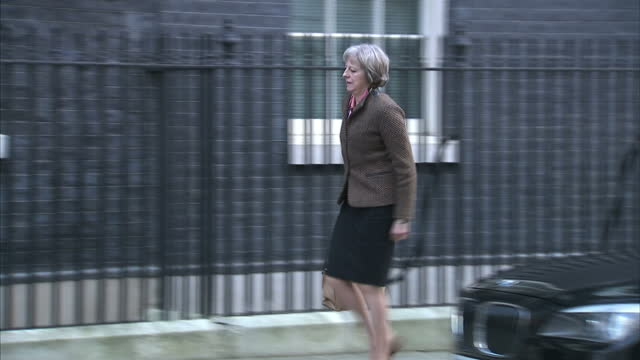 Shows exterior shots UK Home Secretary Theresa May getting out of car and walking into No 10 Downing Street The bosses of more than a third of FTSE...