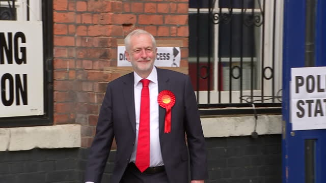 vídeos de stock, filmes e b-roll de shows exterior shots uk labour party leader jeremy corbyn walking out of polling station after voting in the uk general election 2017 on 8th june... - 2017