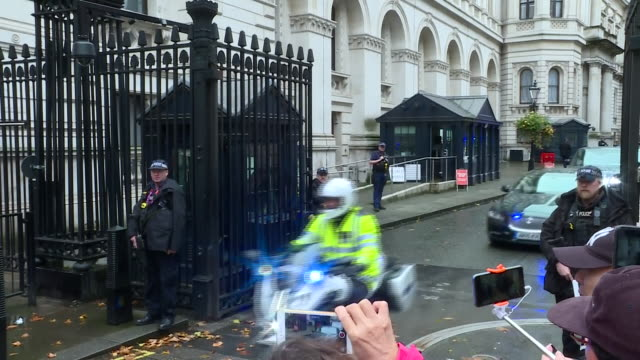 shows exterior shots uk prime minister boris johnson's motorcade leaving downing street on way to houses of parliament for the state opening of... - prime minister of the united kingdom stock videos & royalty-free footage