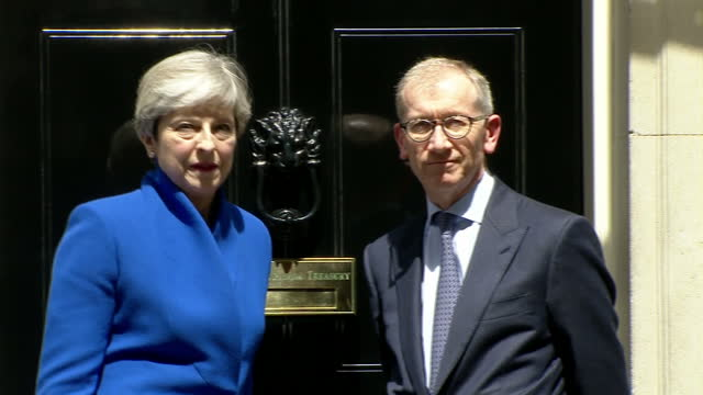 Shows exterior shots UK Prime Minister Theresa May arriving back at Downing Street to give speech after visiting The Palace to seek permission from...
