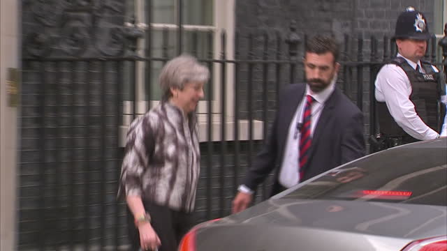 Shows exterior shots UK Prime MInister Theresa May getting into car outside Number 10 and motorcade departing Downing Street Theresa May is this...