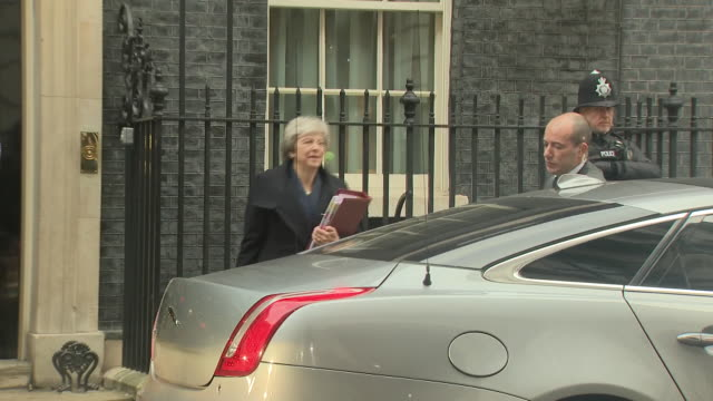 shows exterior shots uk prime minister theresa may leaving downing street as reporters shout about the no confidence vote theresa may has vowed to... - prime minister of the united kingdom stock videos and b-roll footage