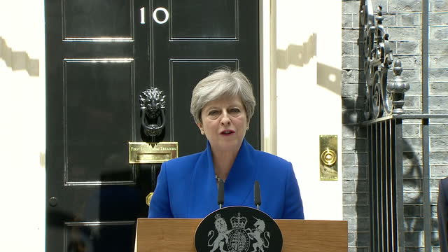 shows exterior shots uk prime minister theresa may leaving downing street to visit the queen at buckingham palace to request to form a new government... - belfast stock videos & royalty-free footage