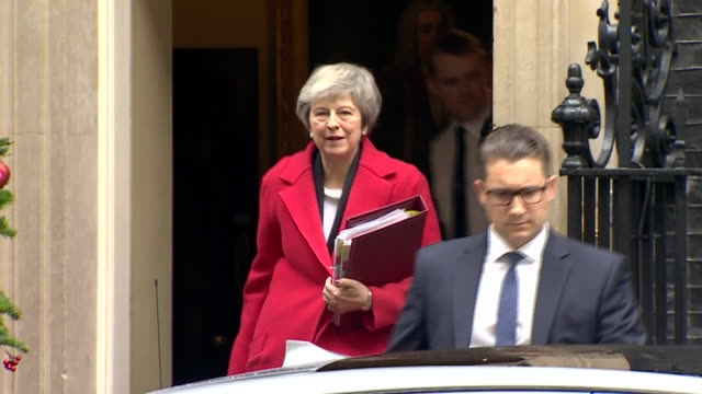 Shows exterior shots UK Prime Minister Theresa May leaving Number 10 Downing Street getting into her car and motorcade driving away History was made...