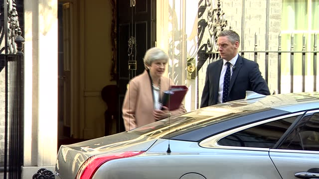 Shows exterior shots UK Prime Minister Theresa May walking out of Number 10 Downing Street and getting in her car on way to Houses of Parliament UK...
