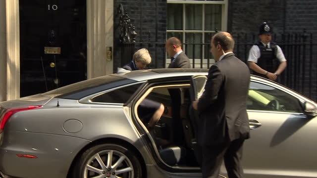 Shows exterior shots UK Prime Minister Theresa May walking out of Number 10 Downing Street and getting in car to leave for Parliament ignoring...