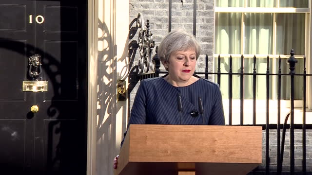 Shows exterior shots UK Prime Minister Theresa May walking out of Number 10 Downing Street to podium to announce she is calling a General Election on...