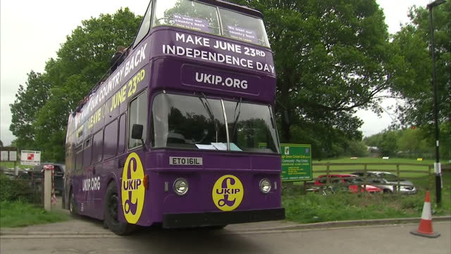 shows exterior shots ukip vote leave campaign bus getting stuck in gateway and driver getting out to look at what the undercarriage is stuck on... - 2016 european union referendum stock videos and b-roll footage