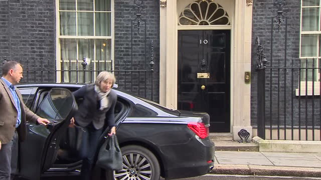 shows exterior shots uk's home secretary theresa may arriving at no 10 downing street with reporters shouting questions. britain will vote on whether... - prime minister's questions stock videos & royalty-free footage