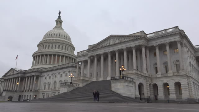 shows exterior shots us capitol building and security personnel stationed outside on cold winter's day on 17th december 2019 in washington dc united... - capitol building stock videos & royalty-free footage