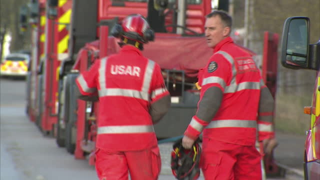 shows exterior shots usar personnel near vehilces at didcot power station rescuers say they believe that three people missing after the didcot power... - didcot stock videos and b-roll footage