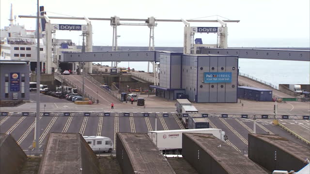 shows exterior shots vehicles and cars driving through port of dover and onto ferries after having passed through border security checks two more... - ferry stock videos & royalty-free footage