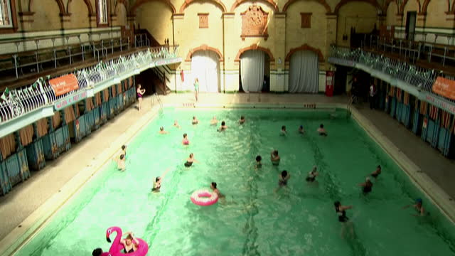 shows exterior shots victoria baths public swimming pool in manchester including signs for three different pools males 1st class males 2nd class and... - gill stock videos and b-roll footage