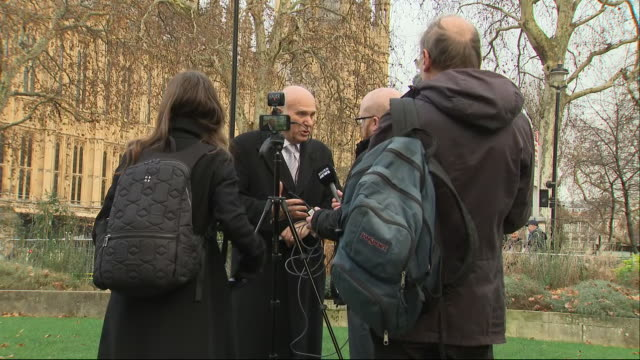 shows exterior shots vince cable, liberal democrats leader, talking to the press outside houses of parliament in westminster. theresa may has delayed... - vince cable stock videos & royalty-free footage