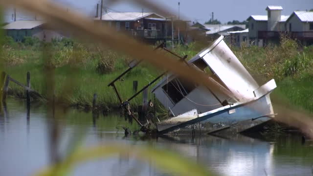 Shows exterior shots waterway boats houses and bridges in the Isla de Jean Charles bayou area of Louisiana USA on August 29 2016 in New Orleans...
