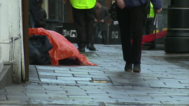 shows exterior shots windsor town centre including tourists wlaking towards windsor castle and chirstmas decorations over the high street exterior... - homeless person stock videos & royalty-free footage