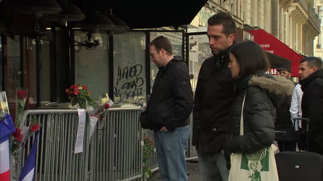shows exterior shots with victims of the bataclan theatre attack returning to scene interviews with victims of attacks including former employee of... - metal clip stock videos and b-roll footage