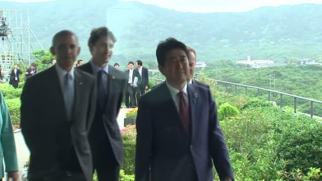 shows exterior shots world leaders walking at g7 summit including italian prime minister matteo renzi uk's prime minister david cameron german... - g7サミット点の映像素材/bロール