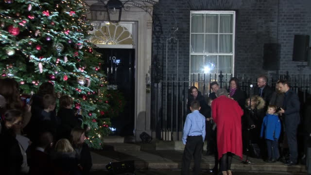 Shows exterior shtos UK Prime Minister Theresa May turning on the Christmas Tree lights outside Number 10 Downing Street in London Cabinet ministers...