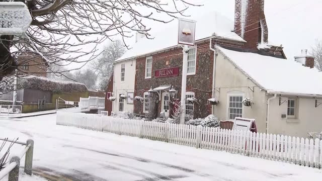 shows exterior shtos village of lydden in kent covered by snow, including streets, signpost, houses, pub, village green and church. heavy snow and... - directional sign stock videos & royalty-free footage