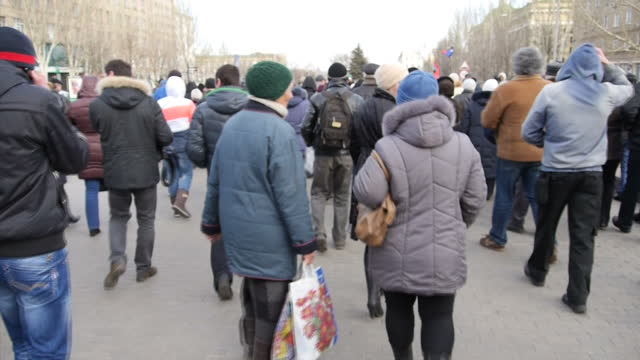 Shows Exteriors Black blue and red pro soviet flag being held high Ukrainian riot police w/ shields guarding government building pro Russian...