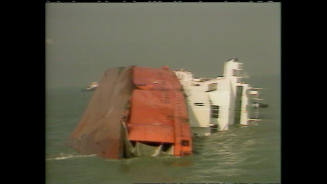 shows ms herald of free enterprise ferry which capsized shortly after leaving the belgian port of zeerbrugge on march 6th 1987 includes footage of... - sinking stock videos & royalty-free footage