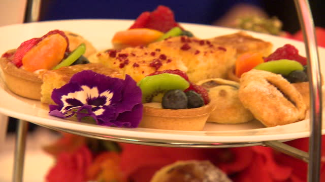 Shows Interior close up shots finger food served at gala dinner including finger sandwiches small tarts and cakes The Duchess of Cambridge today...