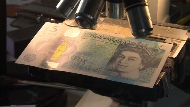 shows interior close up shots microportrait of jane austen engraved on new polymer five pound note four new 5pound notes could be worth as much as... - engraved image stock videos and b-roll footage