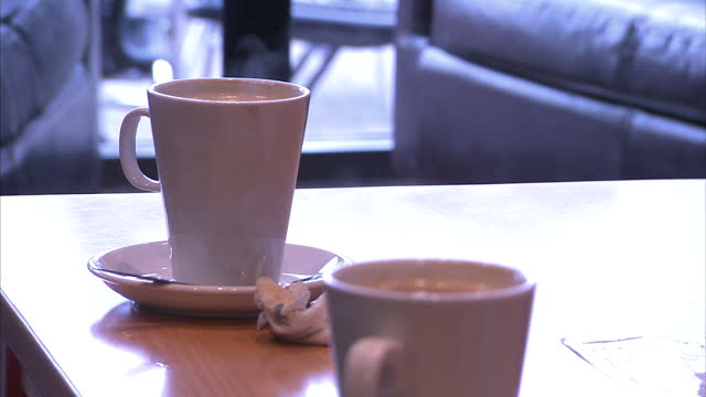 Shows Interior close up shots of steam rising from coffee cups on cafe table on November 10 2015 in London England