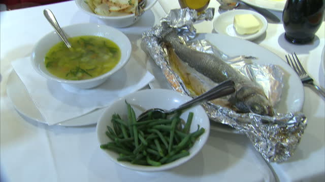 shows interior close up shots various foods key to the mediterranean diet including fish vegetables and salad on august 29 2016 in london england - cucina mediterranea video stock e b–roll