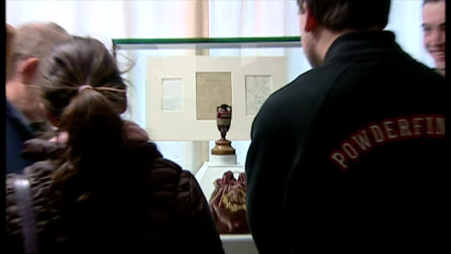 Shows interior people looking at the Ashes urn on display at the Lord's Cricket Museum on January 01 2005 in London England