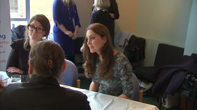 Shows interior shot the Duchess of Cambridge sat at table with guests at Family Friends charity event on January 19 2015 in London England