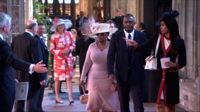 shows interior shots actor idris elba with actress sabrina dhowrem followed by oprah winfrey arriving at st george's chapel for the wedding of prince... - oprah winfrey stock videos & royalty-free footage