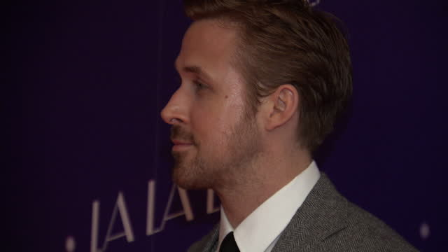 shows interior shots actor ryan gosling posing for photographers on the red carpet at the uk premiere of la la land on 12th january, 2017 in london,... - ryan gosling stock videos & royalty-free footage