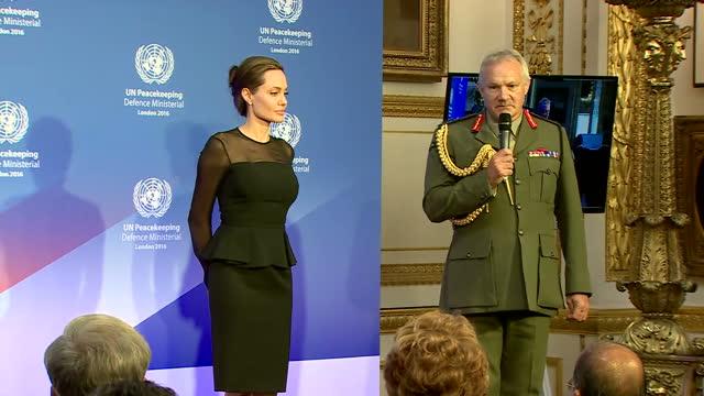 Shows interior shots actress Angelina Jolie Pitt walking into room with UK's Defence Secretary Michael Fallon General Sir Gordon Messenger Vice Chief...