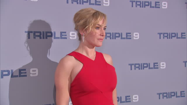 shows interior shots actress kate winslet posing for photos on the red carpet at premiere of film 'triple 9' and interior shots of kate winslet... - kate winslet stock-videos und b-roll-filmmaterial