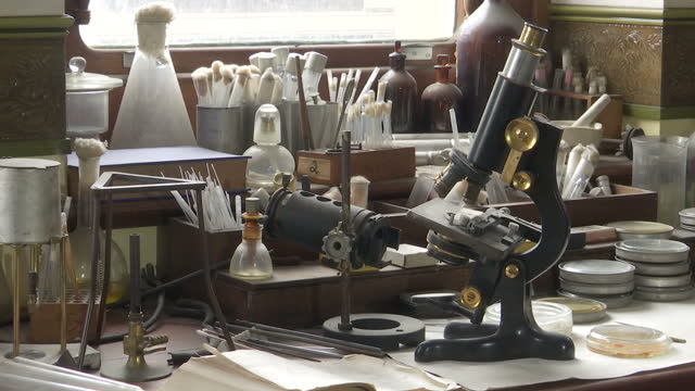 shows interior shots alexander fleming's laboratory including his work desk medical research equipment and petri dishes in st mary's hospital in... - antibiotic resistant stock videos and b-roll footage