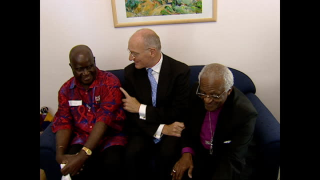 shows interior shots archbishop desmond tutu joking with judge edwin cameron and former president of zambia kenneth kaunda in front of the press on... - kenneth kaunda stock videos & royalty-free footage