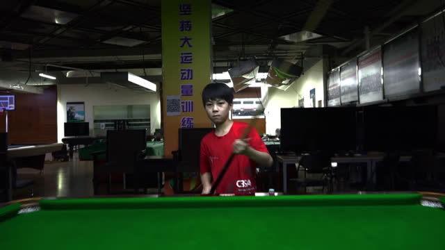 shows interior shots aspiring chinese child snooker player ma hailong training and playing a game of snooker and with his coach. timelapse shots... - school child stock videos & royalty-free footage