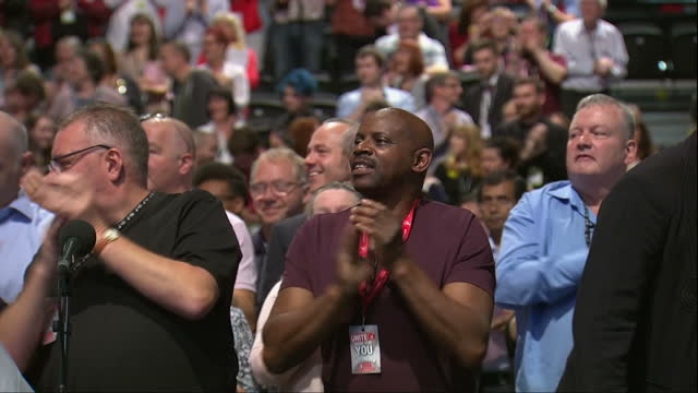 shows interior shots audience on feet clapping and chanting as uk labour party leader jeremy corbyn stands on stage with deputy leader tom watson... - diane abbott stock videos & royalty-free footage