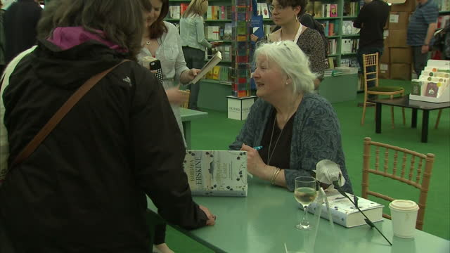 vídeos de stock e filmes b-roll de shows interior shots author barbara erskine signing copies of her books at book signing event at hayonwye literary festival on may 30 2016 in... - hay on wye