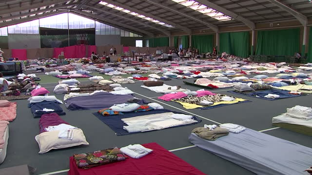 Shows interior shots bedding laid out in sports hall with survivors of the Grenfell Tower Block fire resting in temporary shelter Survivors of the...
