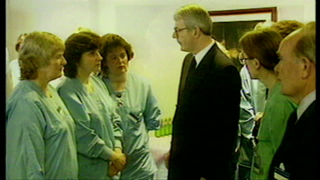 shows interior shots british prime minister john major and labour leader tony blair talking to staff and nurses at stirling royal infirmary on visit... - dunblane school massacre stock videos & royalty-free footage