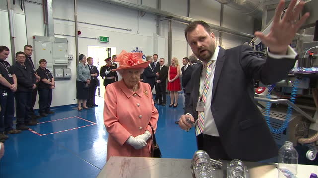 vídeos de stock, filmes e b-roll de shows interior shots bryan mccluskey explaining the production line process to queen elizabeth ii on her tour of the new highland spring factory on... - 2017