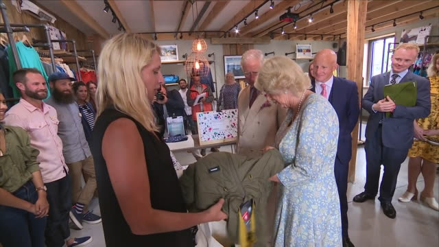 shows interior shots camilla duchess of cornwall and prince charles prince of wales being presented with gifts from finisterre clothing shop on a... - cornwall england stock-videos und b-roll-filmmaterial