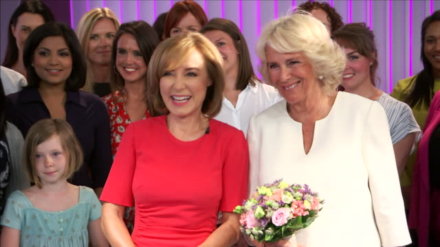 shows interior shots camilla duchess of cornwall being given a tour of 5 news tv studio and posing for a photo with the team. camilla duchess of... - team photo stock videos & royalty-free footage