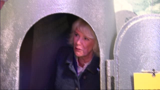 vídeos de stock e filmes b-roll de shows interior shots camilla, duchess of cornwall, trying out a one person air raid shelterat the london transport museum in covent garden on 4th... - air raid
